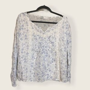 Blue and white patterned long sleeve blouse